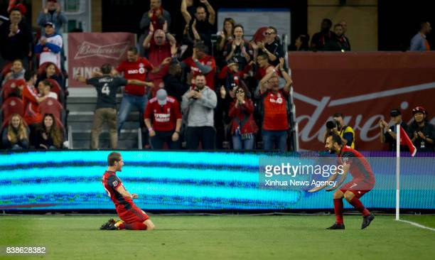 Nicolas Hasler celebrates scoring with Victor Vazquez during the 2017 Major League Soccer match against Philadelphia Union at BMO Field in Toronto...