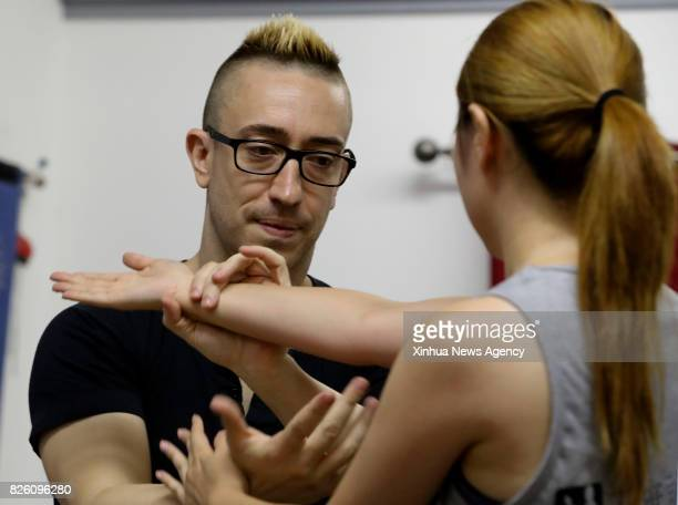 Alex Richter gives personal lesson to his student Xiaomai at his Kung Fu school 'City Wing Tsun' in New York the United States July 12 2017 Hidden in...