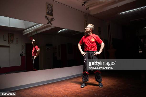 Alex Richter poses for a photo at his Kung Fu school 'City Wing Tsun' in New York the United States July 17 2017 Hidden in the midtown of bustling...