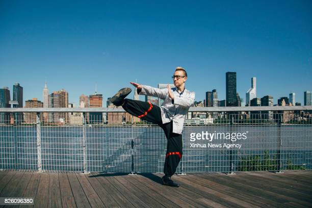 Alex Richter practices Wing Tsun forms at a park in New York the United States July 26 2017 Hidden in the midtown of bustling New York City is 'City...