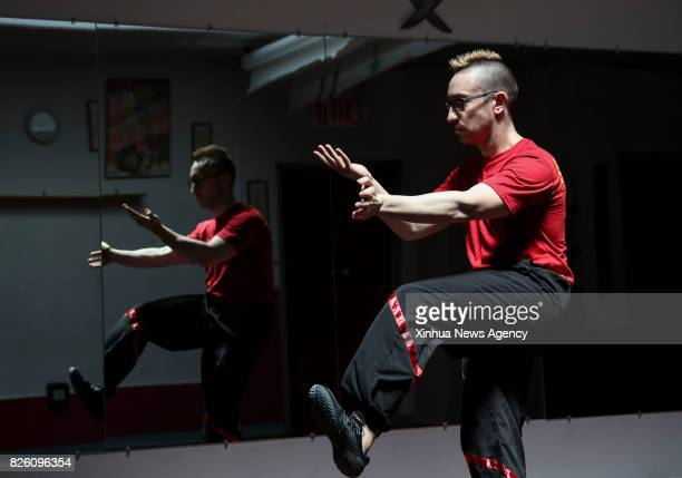 Alex Richter shows Wing Tsun forms at his Kung Fu school 'City Wing Tsun' in New York the United States July 17 2017 Hidden in the midtown of...