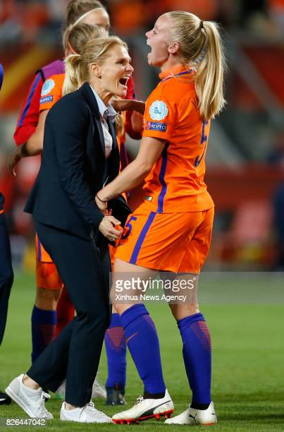 ENSCHEDE Aug 3 2017 Netherlands' head coach Sarina Wiegman celebrates with player Kika van Es after winning a UEFA Women's EURO 2017 soccer...