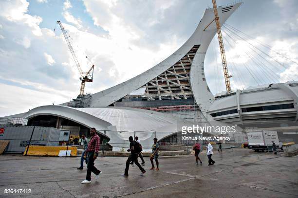 VANCOUVER Aug 4 2017 Asylum seekers enter the Olympic stadium in Montreal of Quebec Cananda Aug 4 2017The number of refugees crossing into Quebec has...