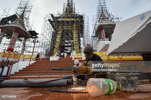 BANGKOK Aug 8 2017 A worker does gas welding at the construction site of the crematorium for the late King Bhumibol Adulyadej in Bangkok Thailand Aug...