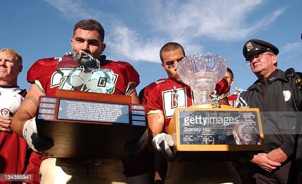 Augie Hoffman and Josh Ott of Boston College kiss their trophies after defeating Notre Dame 2725 at Alumni Stadium in Newton MA