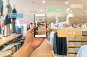 Augmented reality marketing. Hand holding smart phone use AR application to check information