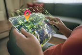 Augmented reality on a tablet. 3D map element designed by photographer.