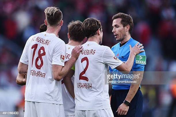 Augsburg players aruge with referee Tobias Stieler during the Bundesliga match between Bayer Leverkusen and FC Augsburg at BayArena on October 4 2015...