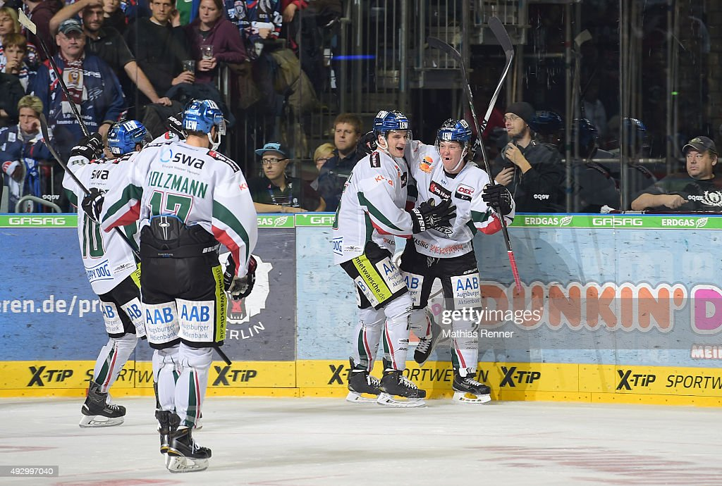 Augsburg Team celebrates after scoring the 1:2 during the game between the Eisbaeren Berlin and Augsburger Panther on October 16, 2015 in Berlin, Germany.