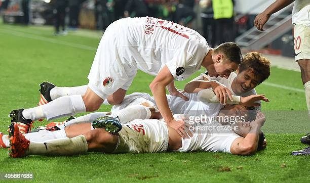 Augsburg's Argentinian striker Raul Bobadilla celebrates scoring with his teammates during the UEFA Europe League football match between FC Augsburg...