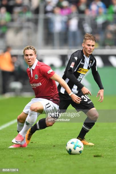 Augsburg's Austrian midfielder Michael Gregoritsch and Moenchengladbach's Swiss defender Nico Elvedi vie for the ball during the German first...