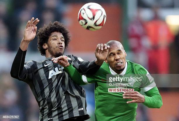 Augsburg's Brazilian midfielder Caiuby and Bremen's Czech defender Theodor Gebre Selassie vie during the German first division Bundesliga football...