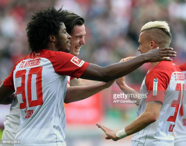 Augsburg's Brazilian midfielder Caiuby midfielder Michael Gregoritsch and defender Philipp Max celebrate after their first goal during the German...