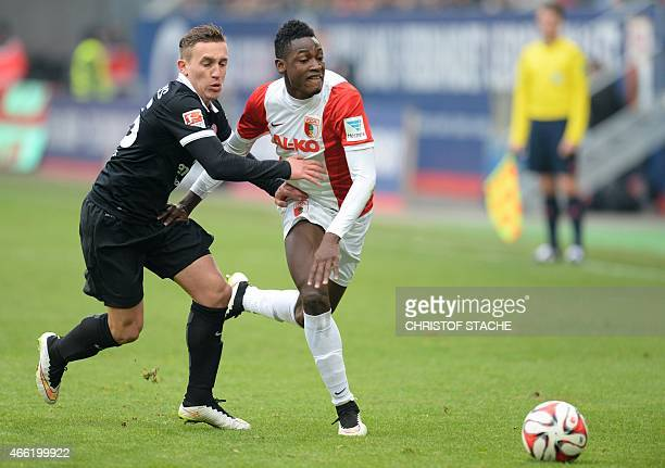 Augsburg's defender Abdul Rahman Baba and Mainz's Argentinian midfielder Pablo de Blasis vie for the ball during the German first division Bundesliga...
