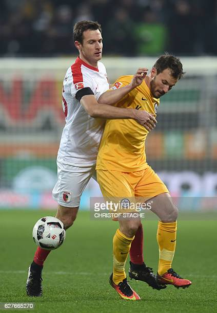 Augsburg's defender Christoph Janker and Frankfurt's Hungarian midfielder Szabolcs Huszti vie for the ball during the German first division...