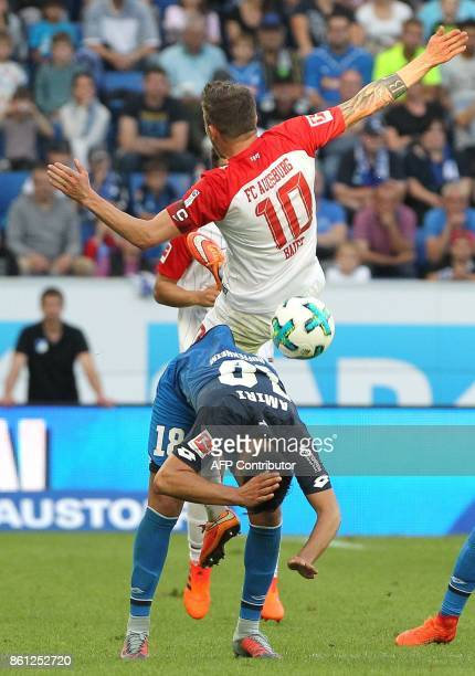 Augsburg's German midfielder Daniel Baier and Hoffenheim's German midfielder Nadiem Amiri vie for the ball during the German First division...