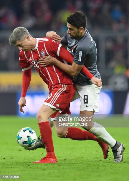 Augsburg's German midfielder Rani Khedira and Bayern Munich's Polish forward Robert Lewandowski vie for the ball during the German first division...