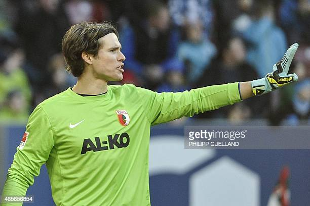 Augsburgs goalkeeper Marwin Hitz gestures during the German first division Bundesliga football match FC Augsburg v VfL Wolfsburg in Augsburg southern...