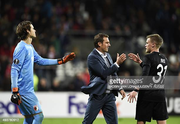 Augsburg's goalkeeper Marwin Hitz head coach Markus Weinzierl and defender Philipp Max celebrate their win in the UEFA Europa League Group L football...