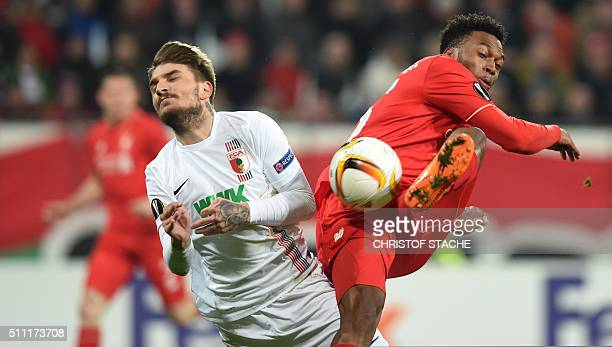 Augsburg's Greece defender Konstantinos Stafylidis and Liverpool's striker Daniel Sturridge vie for the ball during the UEFA Europa League Round of...