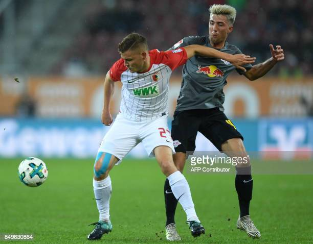 Augsburg's Icelandic forward Alfred Finnbogason and Leipzig's Slovanian midfielder Kevin Kampl vie for the ball during the German First division...