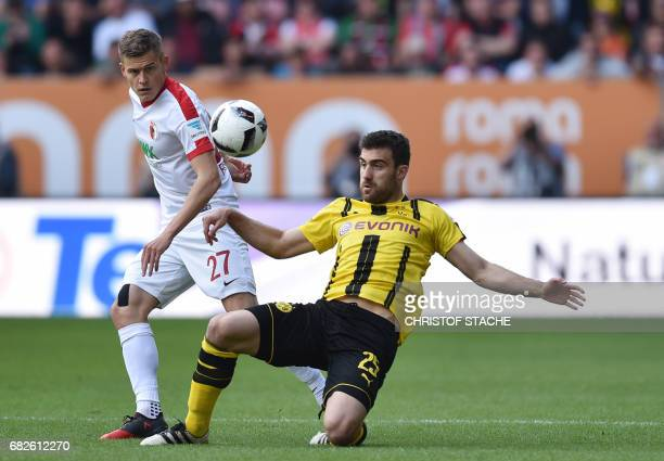 Augsburg's Icelandic forward Alfred Finnbogason vies for the ball with Dortmund's Greek defender Sokratis during the German first division Bundesliga...