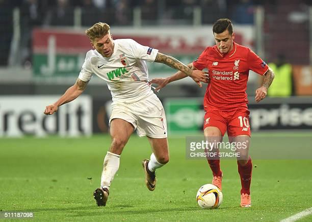 Augsburg's midfielder Alexander Esswein and Liverpool's Brazilian midfielder Coutinho vie for the ball during the UEFA Europa League Round of 32...