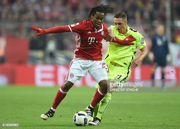 Augsburg's midfielder Dominik Kohr and Bayern Munich's Portuguese midfielder Renato Sanches vie for the ball during the German Cup DFB Pokal second...