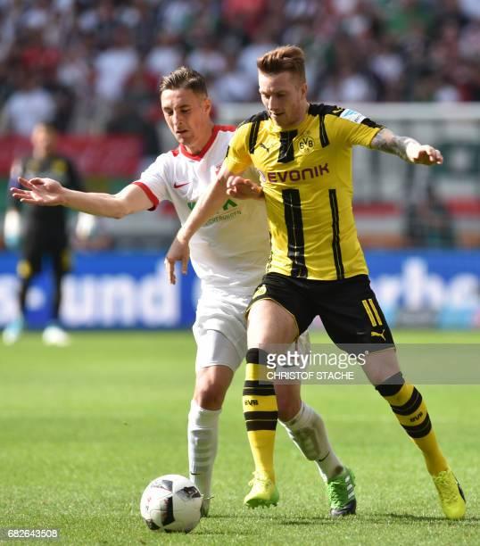 Augsburg's midfielder Dominik Kohr and Dortmund's midfielder Marco Reus vie for the ball during the German first division Bundesliga football match...