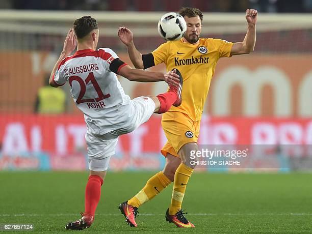Augsburg's midfielder Dominik Kohr and Frankfurt's Hungarian midfielder Szabolcs Huszti vie for the ball during the German first division Bundesliga...