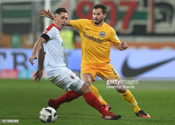 Augsburg's midfielder Dominik Kohr and Frankfurt's Hungarian midfielder Szabolcs Huszti vie for the ball vie for the ball during the German first...