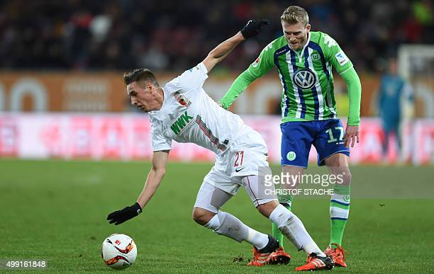 Augsburg's midfielder Dominik Kohr and Wolfsburg's midfielder Andre Schuerle vie for the ball during the German first division Bundesliga football...
