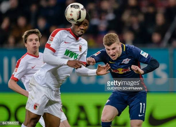 Augsburg's midfielder Kevin Danso and Leipzig's German striker Timo Werner vie for the ball during the German first division Bundesliga football...