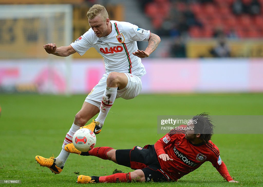Augsburg's midfielder Kevin Vogt (L) and Leverkusen's defender Gonzalo Castro vie for the ball during the German first division Bundesliga football match Bayer Leverkusen vs FC Augsburg in Leverkusen, western Germany on February 16, 2013. AFP PHOTO / PATRIK STOLLARZ