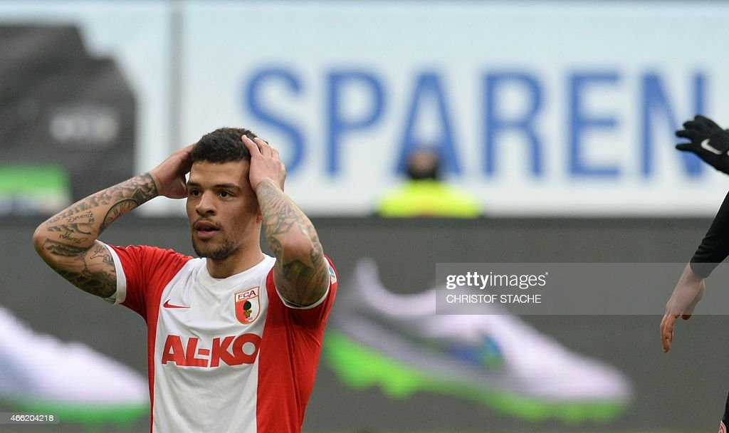 Augsburg's midfielder <a gi-track='captionPersonalityLinkClicked' href=/galleries/search?phrase=Shawn+Parker+-+Soccer+Player&family=editorial&specificpeople=5385069 ng-click='$event.stopPropagation()'>Shawn Parker</a> reacts during the German first division Bundesliga football match FC Augsburg v Mainz 05 in Augsburg, southern Germany, on March 14, 2015. AFP PHOTO / CHRISTOF STACHE