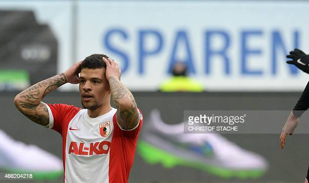 Augsburg's midfielder Shawn Parker reacts during the German first division Bundesliga football match FC Augsburg v Mainz 05 in Augsburg southern...