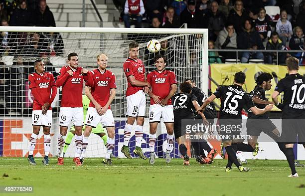 Augsburg's Piotr Trochowski scroe a free kick during the UEFA Europa League Group L football match between AZ Alkmaar and Augsburg in Alkmaar on...