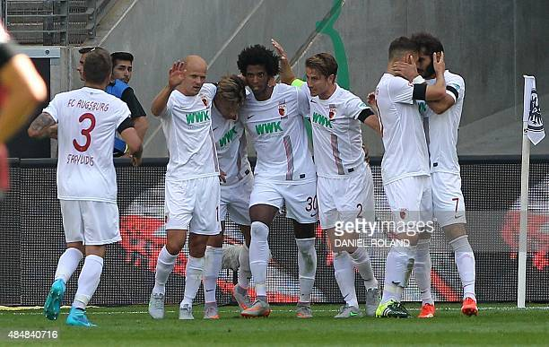 Augsburg's players celebrate Augsburg's Brazilian midfielder Caiuby scoring the 10 during the German first division Bundesliga football match...