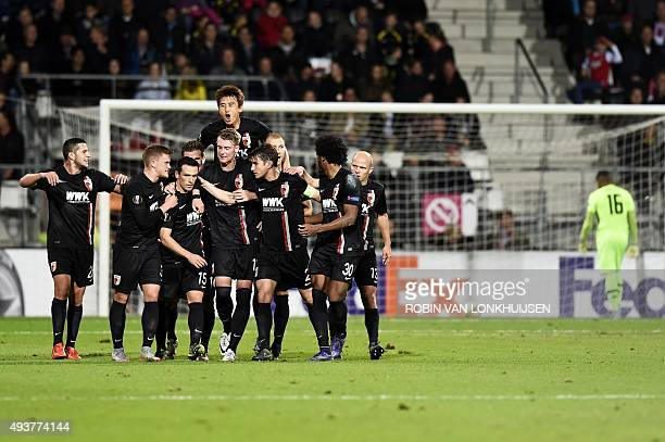 Augsburg's players celebrate opening the scoring during the UEFA Europa League Group L football match between AZ Alkmaar and Augsburg in Alkmaar on...