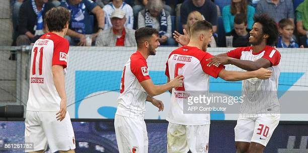 Augsburg's players celebrate the 22 own goal during the German First division Bundesliga football match TSG 1899 Hoffenheim vs FC Augsburg in...