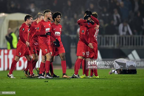 Augsburg's players celebrate their victory after the UEFA Europa League football match between FK Partizan and FC Augsburg at FK Partizan stadium in...