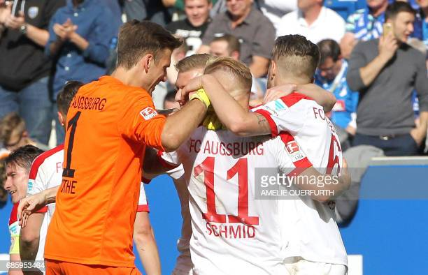 Augsburg's players react after during the German first division football match between TSG Hoffenheim 1899 and FC Augsburg on May 20 2017 in Sinsheim...
