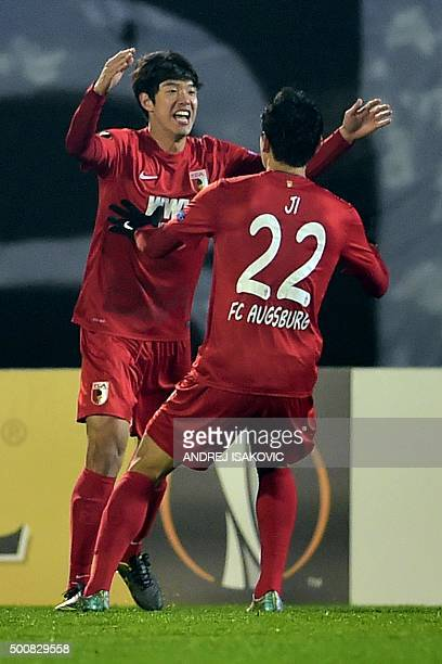 Augsburg's South Korean defender Hong JeonHo celebrates with Augsburg's South Korean forward Ji DongWon Dongwon Ji after scoring a goal during the...