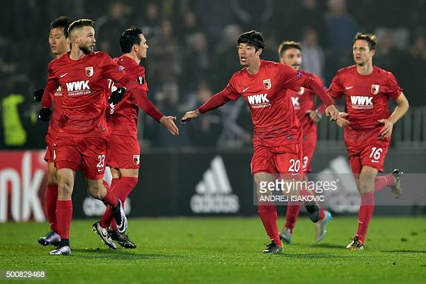 Augsburg's South Korean defender Hong JeonHo celebrates with teammates after scoring a goal during the UEFA Europa League Group L football match...