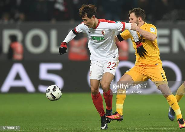 Augsburg's South Korean forward DongWon Ji and Frankfurt's Hungarian midfielder Szabolcs Huszti vie for the ball vie for the ball during the German...