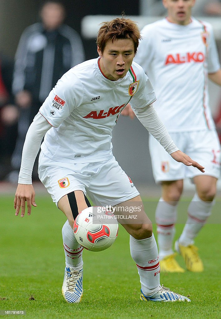 FC Augsburg's South Korean midfielder Ja-Cheol Koo plays the ball during the German first division Bundesliga football match Bayer Leverkusen vs FC Augsburg in Leverkusen, western Germany, on February 16, 2013. Leverkusen won the match 2-1.
