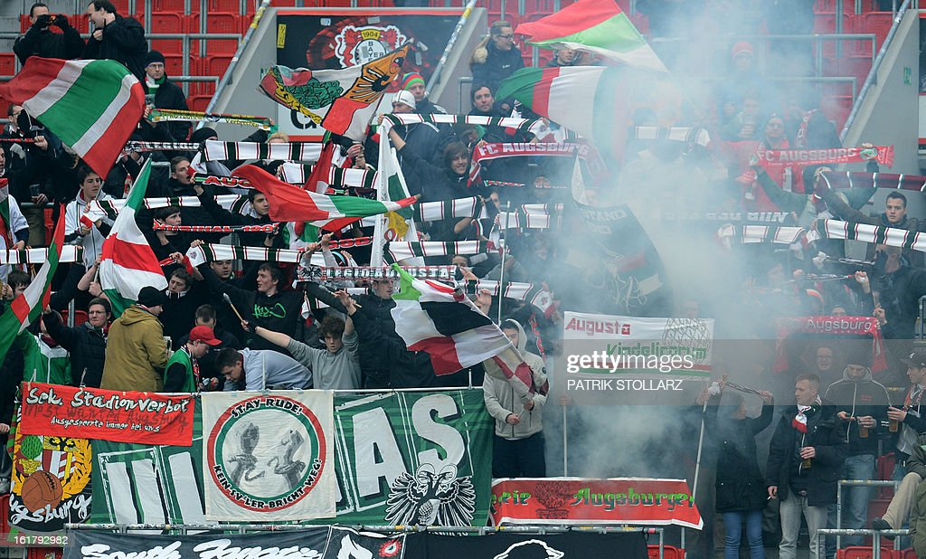FC Augsburg's supporters cheer their team during the German first division Bundesliga football match Bayer Leverkusen vs FC Augsburg in Leverkusen, western Germany, on February 16, 2013. Leverkusen won the match 2-1.