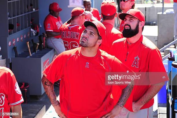 Los Angeles Angels of Anaheim Pitcher Matt Shoemaker [9659] and Los Angeles Angels of Anaheim Pitcher Hector Santiago [8935] watch as a plane sky...