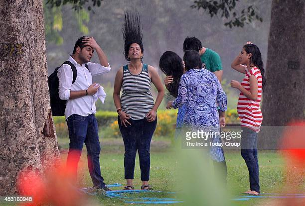 Youngsters enjoy during monsoon rains in New Delhi