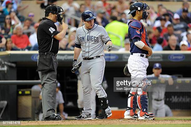 San Diego Padres second baseman Jedd Gyorko argues a called third strike with home plate umpire Mike DiMuro in the fourth inning of a Major League...
